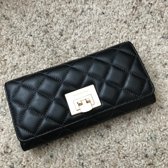 a0ae8f0d4e3a Michael Kors Bags | Wallet Astrid Carry All Quilted | Poshmark